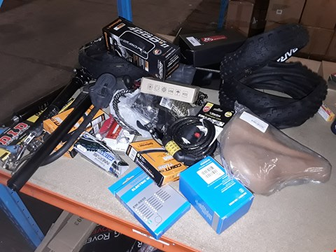 Lot 3009 LARGE ASSORTMENT OF BICYCLE PARTS, INCLUDING, TYRES, INNER TUBES, SADDLE, CHAINS, LIGHT SETS, SHIMANO PRODUCTS, DISK BRAKES, SUSPENSION UNITS, CABLE LOCKS,
