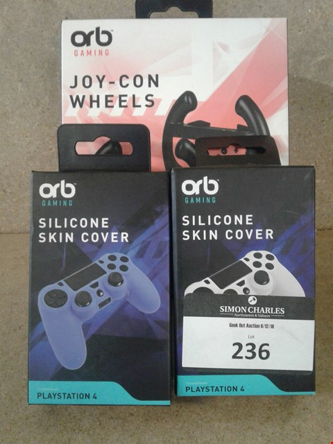 Lot 236 3 BRAND NEW BOXED ORB ITEMS TO INCLUDE ORB GAMING JOY-CON WHEELS AND ORB GAMING SILICONE SKIN COVER BLUR AND WHITE