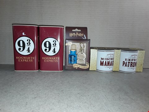 Lot 210 LOT OF 4 BRAND NEW HARRY POTTER ITEMS TO INCLUDE BOXED LIGHT UP KEY RING, BOXED MINI MUG SET AND 2X HOGWARTS EXPRESS MONEY BANK