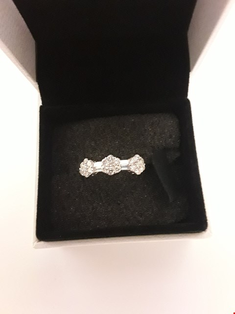 Lot 282 18CT WHITE GOLD FLORAL DESIGN RING SET WITH DIAMONDS WEIGHING +/- 0.60CT