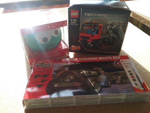 Lot 9050 A PASS THE PARCEL NOVELTY GIFT, A LEGO TECHNIC AND A 1:72 BRITISH AIRBORNE WILLYS JEEP