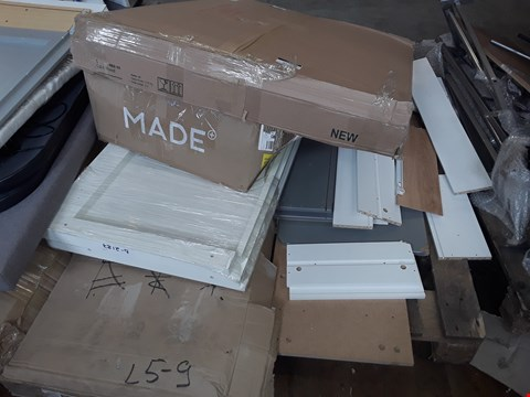 Lot 5114 SMALL PALLET OF ASSORTED FLAT PACK FURNITURE PARTS