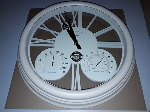 Lot 117 CREAM EXETER WALL CLOCK AND THERMOMETER RRP £40