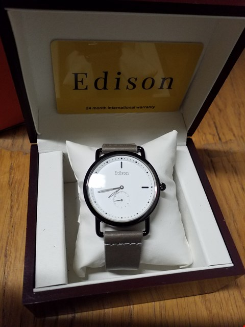Lot 97 EDISON WRIST WATCH WITH BLACK METAL CASING, WHITE DIAL & GREY LEATHER STRAP