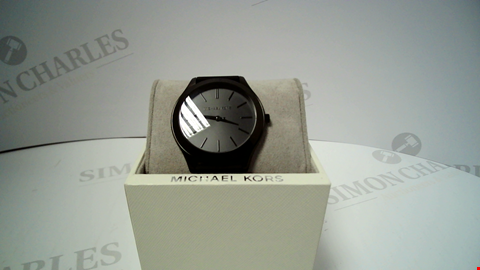 Lot 18036 DESIGNER BLACK STRAP AND DIAL WRISTWATCH