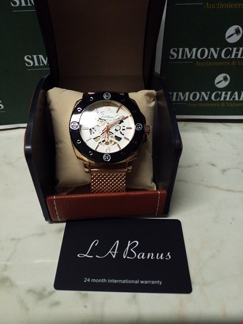 Lot 4585 L. A BANUS WHITE DIAL GOLD EFFECT CASE SKELETON WATCH WITH ROSE GOLD EFFECT WRIST STRAP