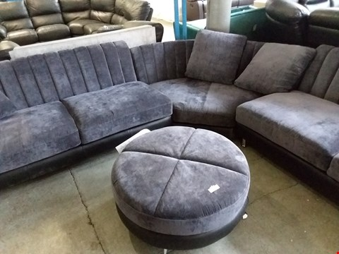 Lot 47 DESIGNER CHARCOAL FABRIC AND BLACK FAUX LEATHER LARGE CORNER SOFA WITH CIRCULAR FOOTSTOOL