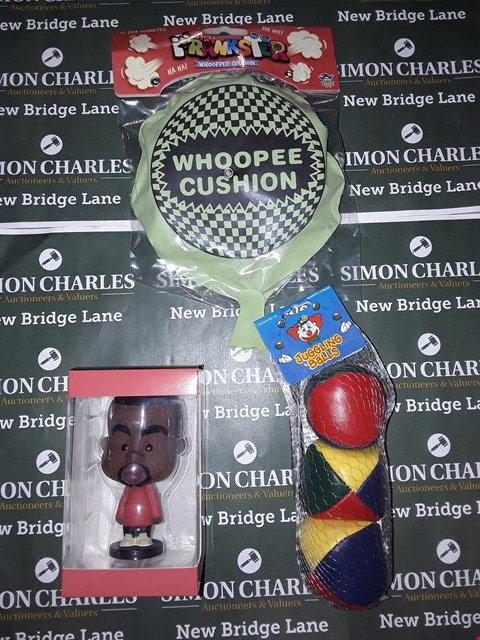 Lot 774 BOX OF ASSORTED TOY ITEMS TO INCLUDE A WHOOPEE CUSHION, LIL YE FIGURINE, JUGGLING BALLS ETC