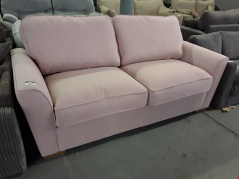 Lot 2034 DESIGNER PINK FABRIC THREE SEATER SOFA