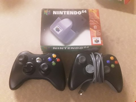Lot 325 2 XBOX CONTROLLERS AND NINTENDO 64 RUMBLE PACK