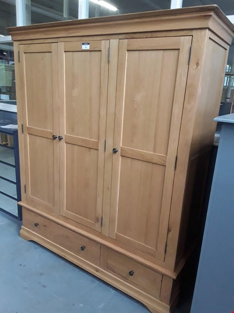 Lot 95 DESIGNER NORMANDY OAK TRIPLE DOOR WARDROBE ON 2 DRAWER BASE