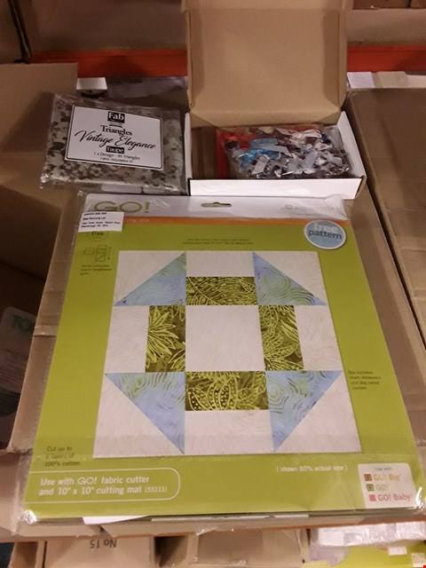 """Lot 2698 BOX OF APPROXIMATELY 10 CRAFT ITEMS TO INCLUDE ACCUQUILT GO CHURN DASH 9"""" FINISHED DIE, DISNEY RIBBON AND BOW ASSORTMENT 55 AND TRIANGLES VINTAGE ELEGANCE TAUPE DESIGN"""