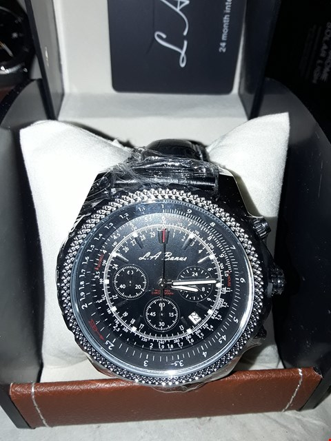 Lot 19 DESIGNER L A BANUS GENTS CHRONOGRAPH WRIST WATCH WITH GRILL BEZEL ON BLACK STRAP WITH LEATHER BOX RRP £495