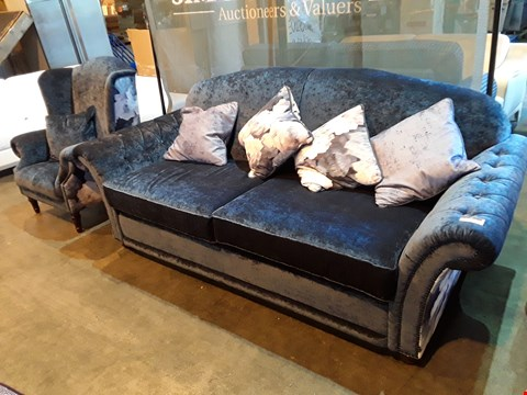 Lot 1006 DESIGNER JOHN FLEMING UPHOLSTERY DIPLOMAT BLUE VELVET SUITE, COMPRISING THREE SEATER SHAPED BACK SOFA WITH SCATTER CUSHIONS & WINGED ARMCHAIR, WITH STUDDED DETAIL & FLORAL FABRIC SIDE & BACK PANE