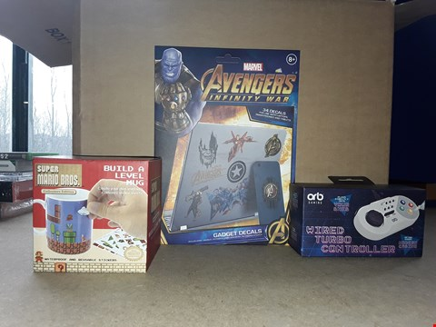 Lot 2236 BOX OF APPROXIMATELY 46 ITEMS TO INCLUDE AVENGERS INFINITY WAR GADGET DECALS, SUPER MARIO BROS MUG, ORB WIRED TURBO CONTROLLER FOR NES, ECT
