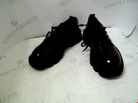 Lot 103 LOT OF APPROXIMATELY 20 ASSORTED BOXED AND UNBOXED PAIRS OF DESIGNER FOOTWEAR TO INCLUDE ZARA, FILA, BALLY ETC.