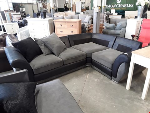 Lot 98 DESIGNER BLACK FAUX LEATHER AND CHARCOAL FABRIC CORNER SOFA WITH SCATTER BACK CUSHIONS