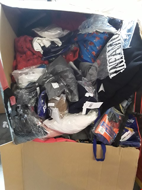 Lot 54 CAGE OF A SIGNIFICANT QUANTITY OF ASSORTED CLOTHING ITEMS