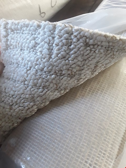 Lot 642 ROLL OF CREAM CARPET APPROXIMATELY 4X1.5M