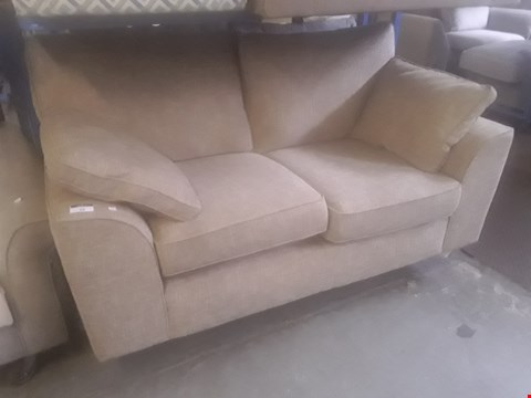Lot 25 QUALITY BRITISH DESIGNER BEIGE FABRIC TWO SEATER SOFA WITH BOLSTER CUSHIONS