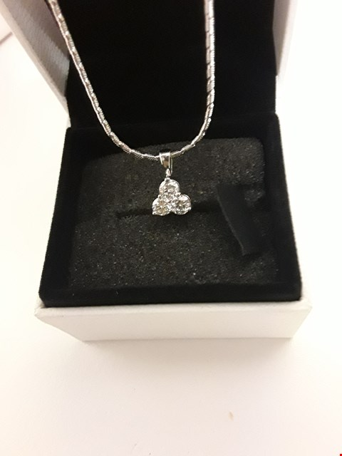 Lot 281 18CT WHITE GOLD TREFOIL PENDANT ON CHAIN SET WITH DIAMONDS WEIGHING +/- 0.60CT