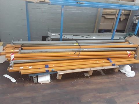 Lot 2129 LOT OF 5 ASSORTED PALLETS AND TROLLEYS CONTAINING VARIOUS METAL STORAGE RACKING COMPONENTS