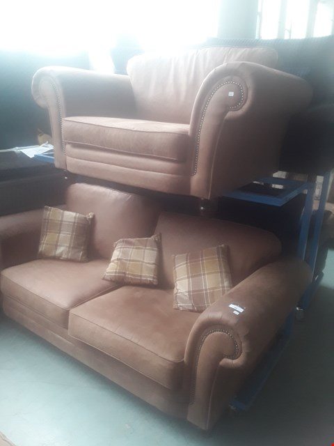 Lot 92 DESIGNER TAN SUEDE STUDDED SCROLL ARM SUITE, COMPRISING, THREE SEATER SOFA & SNUGGLE CHAIR