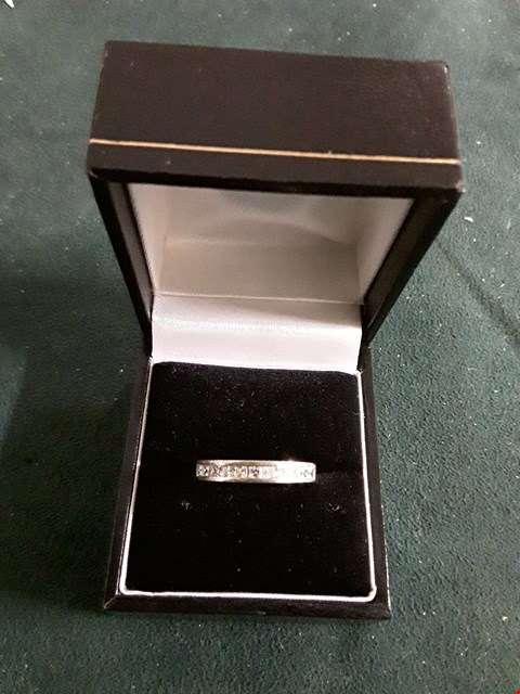 Lot 8240 WHITE METAL RING SET WITH STONES