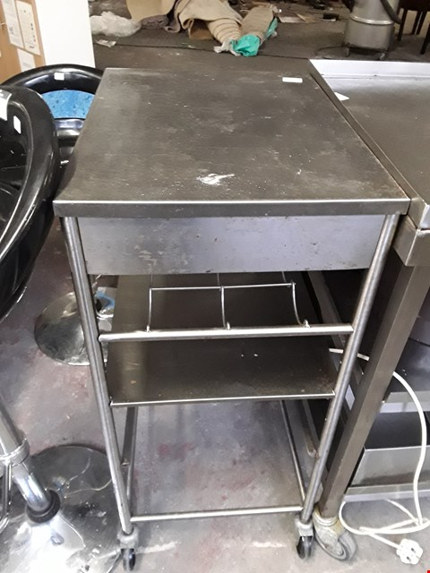 Lot 7 COMMERCIAL STAINLESS STEEL WHEELED TABLE WITH BOTTLE STORAGE