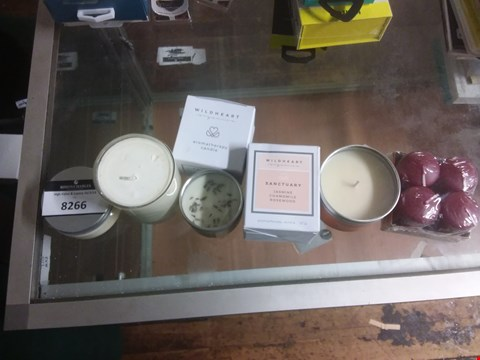 Lot 8266 A LOT OF SIX ASSORTED CANDLES