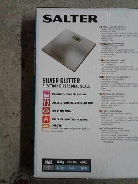 Lot 779 LOT OF 2 ITEMS TO INCLUDE A SALTER SILVER GLITTER ELECTRONIC PERSONAL SCALE AND LIT WOOD CANDLE BRIDGE SCENE  RRP £72
