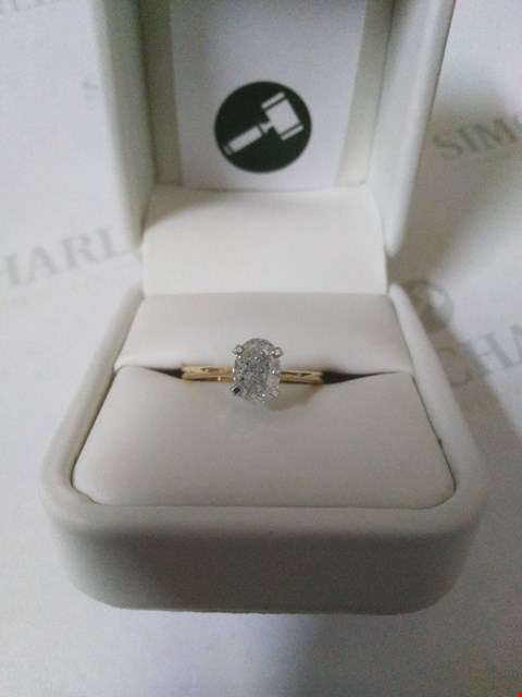Lot 53 18CT GOLD SOLITAIRE RING SET WITH AN OVAL CUT DIAMOND WEIGHING +1.15CT RRP £5100.00