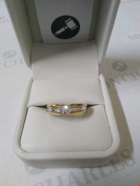 Lot 26 18CT GOLD DESIGNER RING SET WITH A MARQUISE CUT DIAMOND RRP £2100.00