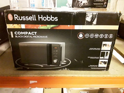 Lot 534 RUSSELL HOBBS COMPACT DIGITAL MICROWAVE