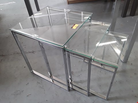Lot 384 DESIGNER CHROME FRAMED GLASS TOP NEST OF THREE TABLES