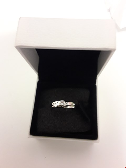 Lot 277 18CT WHITE GOLD RING WITH A RUBOVER-SET DIAMOND WEIGHING +/- 0.13CT