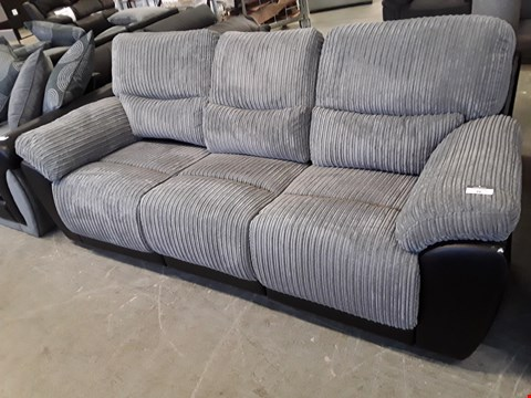 Lot 26 DESIGNER BLACK FAUX LEATHER AND GREY JUMBO CORD SIENNA MANUAL RECLINING 3 SEATER SOFA  RRP £989.00