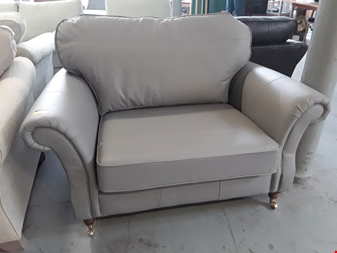 Lot 168 QUALITY BRITISH DESIGNER LIGHT GREY LEATHER SNUGGLE CHAIR ON BRASS CASTORS