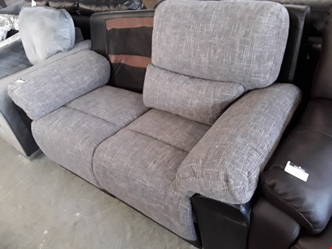Lot 18 DESIGNER BLACK FAUX LEATHER AND GREY FABRIC MANUAL RECLINING 2 SEATER SOFA