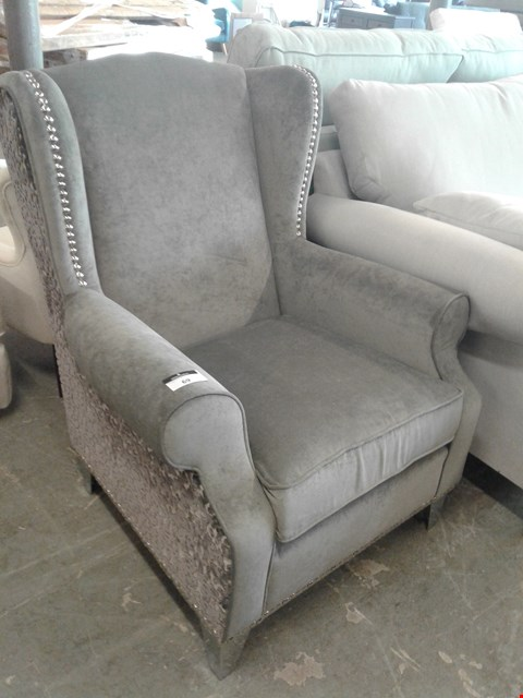 Lot 69 DESIGNER SILVER FABRIC WING BACK ARMCHAIR