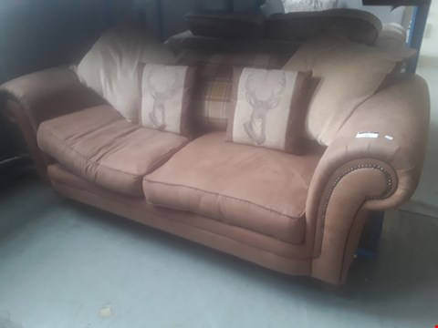 Lot 91 DESIGNER TAN SUEDE STUDDED SCROLL ARM THREE SEATER SOFA WITH SCATTER CUSHIONS
