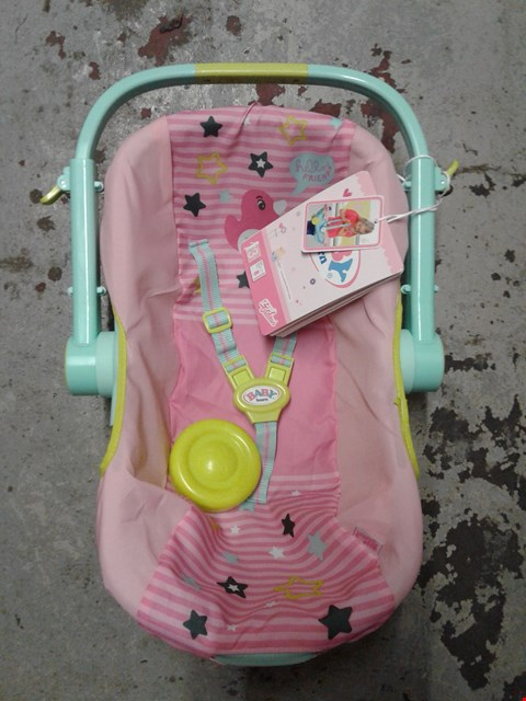 Lot 629 LOT OF 2 ITEMS TO INCLUDE BABY BORN COMFORT TRAVEL SEAT AND PAW PATROL SKYE AND EVEREST MY FIRST TRIKE RRP £62