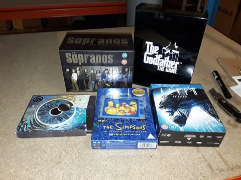 Lot 4102 JOB LOT OF ASSORTED CD/DVD BOXSETS , BOOKS AND GAMES TO INCLUDE PINK FLOYD, THE SIMPSONS,  THE GODFATHER(4 BOXES)