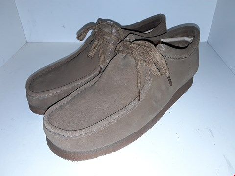 Lot 1011 A PAIR OF SUEDE WALLABEES UK SIZE 10