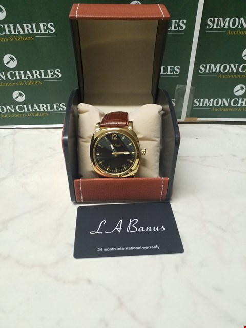 Lot 4590 L. A BANUS BLACK DIAL GOLD EFFECT CASE WATCH WITH BROWN LEATHER WRIST STRAP