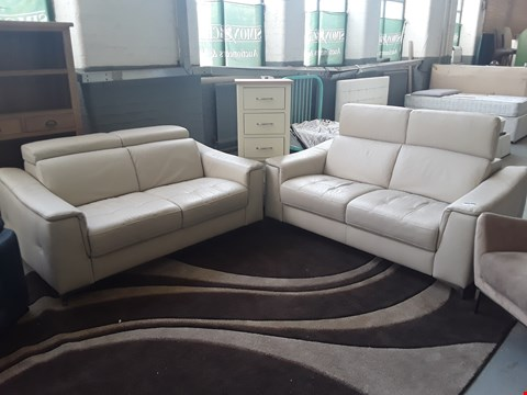 Lot 53 QUALITY ITALIAN DESIGNER CREAM LEATHER PAIR OF STAR 2 SEATER SOFAS WITH ADJUSTABLE HEADRESTS