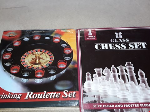 Lot 2143 DRINKING ROULETTE SET AND GLASS CHESS SET