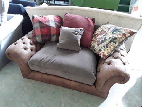 Lot 76 QUALITY BRITISH DESIGNER BROWN LEATHER AND GREY FABRIC SNUGGLE CHAIR WITH ASSORTED SCATTER CUSHIONS