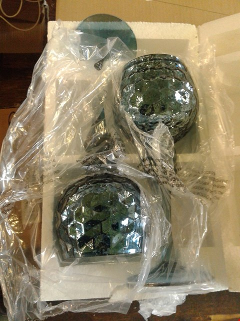 Lot 56 2 × TEAL GLASS CANDLE HOLDERS