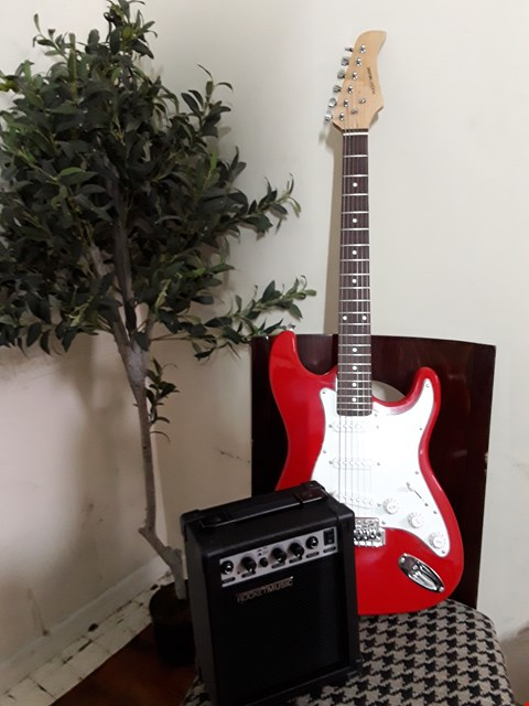 Lot 51 ROCKET MUSIC BEGINNERS GUITAR KIT COMPRISING RED STRATOCASTER STYLE ELECTRIC GUITAR, PRACTICE AMPLIFIER, STAND, STRAP AND ACCESSORIES